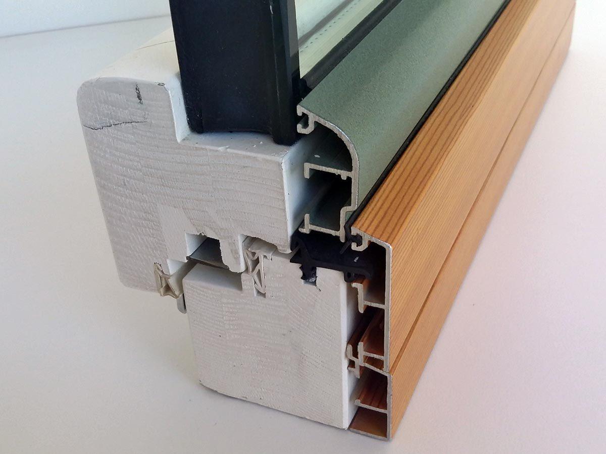 Dettaglio chiusura serramento in legno-alluminio noce con spessore 85 mm